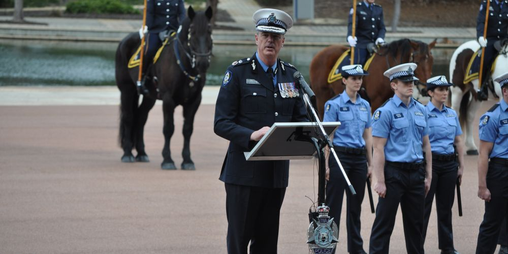 Departing Police Commissioner Karl O'Callaghan speaks at his farewell ceremony. Photo: Mark Donaldson