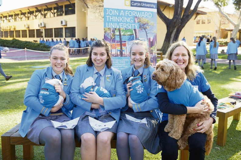 George, with owner Shirley Bode, wins the hearts of students at St Hilda's Anglican School for Girls.