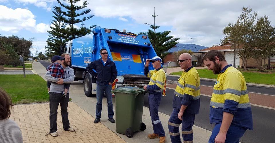 Roman Hill meets his heroes - the rubbish bin men. Pic: Facebook