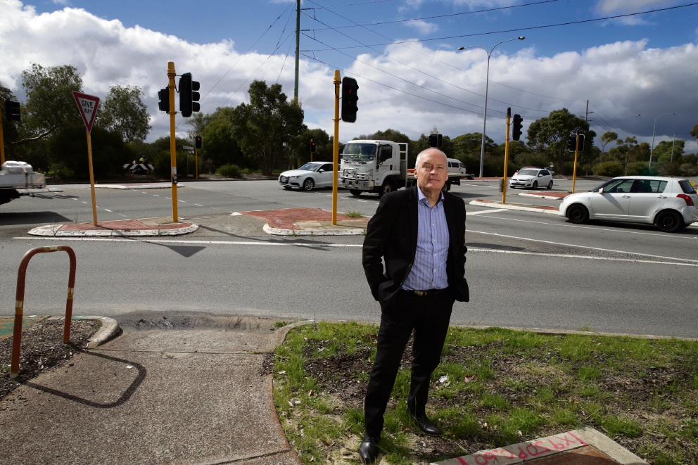 Melville Mayor Russell Aubrey stands at the intersection of Bibra Drive and Farrington Road, which is slated to close in the latest plans for the Murdoch Drive extension.