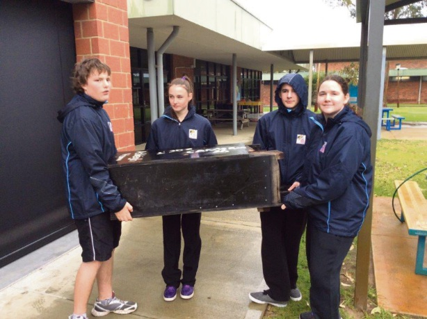 Cameron Shellback (14), Kate Mutton (14), Zac Thorogood (15) and Rachel Pearson (15) with the large Black Cockatoo nesting box.