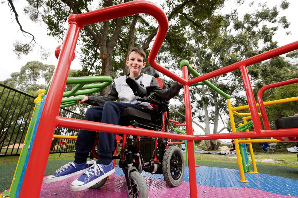 Benjamin Dyer (15) tries out Durham Road School's new playground. Picture: Andrew Ritchie www.communitypix.com.au d472642