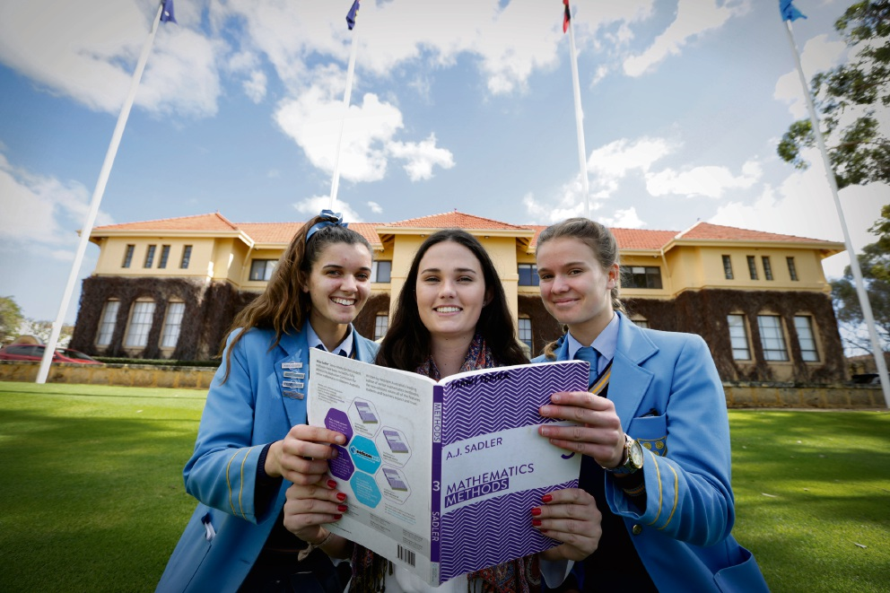 St Hilda's Anglican School Year 12 students Mary Pethick and Charlotte Salom with past student Isabelle Higgins. Picture: Andrew Ritchie www.communitypix.com.au d472085