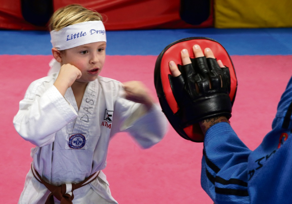 Dash Ferguson, who holds a brown belt in taekwondo, wants to represent Australia at the Olympics one day. Picture: Martin Kennealeyd471394