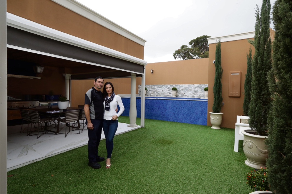 Frank and Sabrina Costa are worried that they will lose their privacy if a six-storey apartment complex is built behind their property in Como. Picture: Martin Kennealey