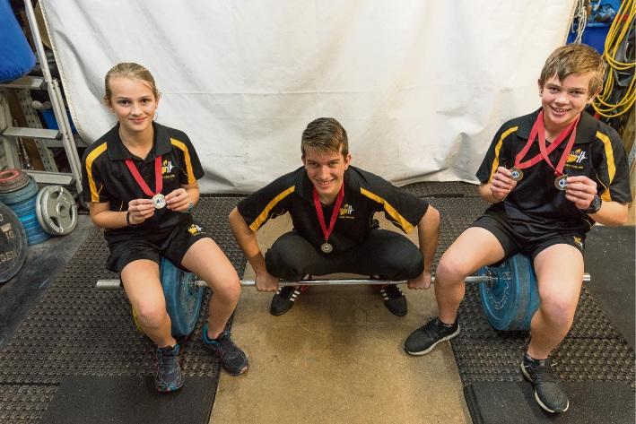 Charlotte, William and Oliver Saxton each bagged medals at the Australian Weightlifting Championships. Picture: Emma Geary