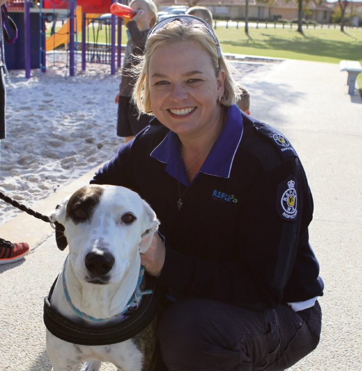 Nat Foster with a dog at a previous community action day.