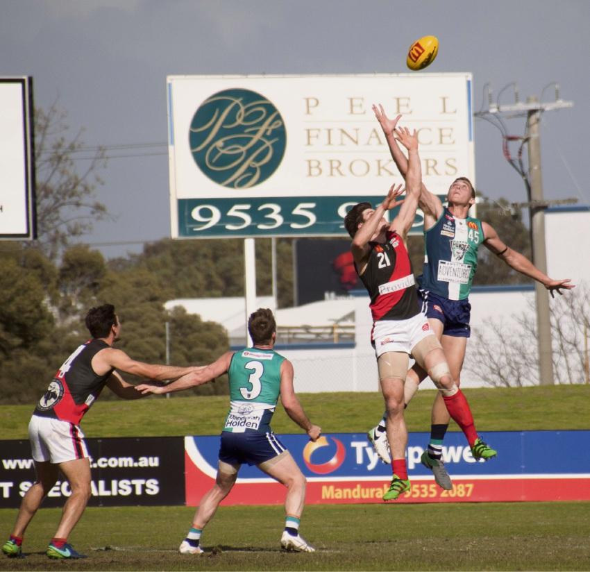 Right: Alexander Bray swoops on the footy during Peel's clash against Perth. Picture: Rachel Fenner.