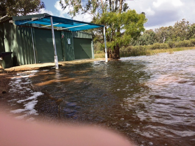 The lake waters rose as high as the canoe hire shed. Picture: Bruce Hunt