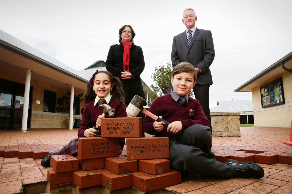 Principal Therese Bandy with original student Bernie Durkin and current students Maddison Gangemi and Rafferty Dunn (8). Picture: Andrew Ritchie  d472576