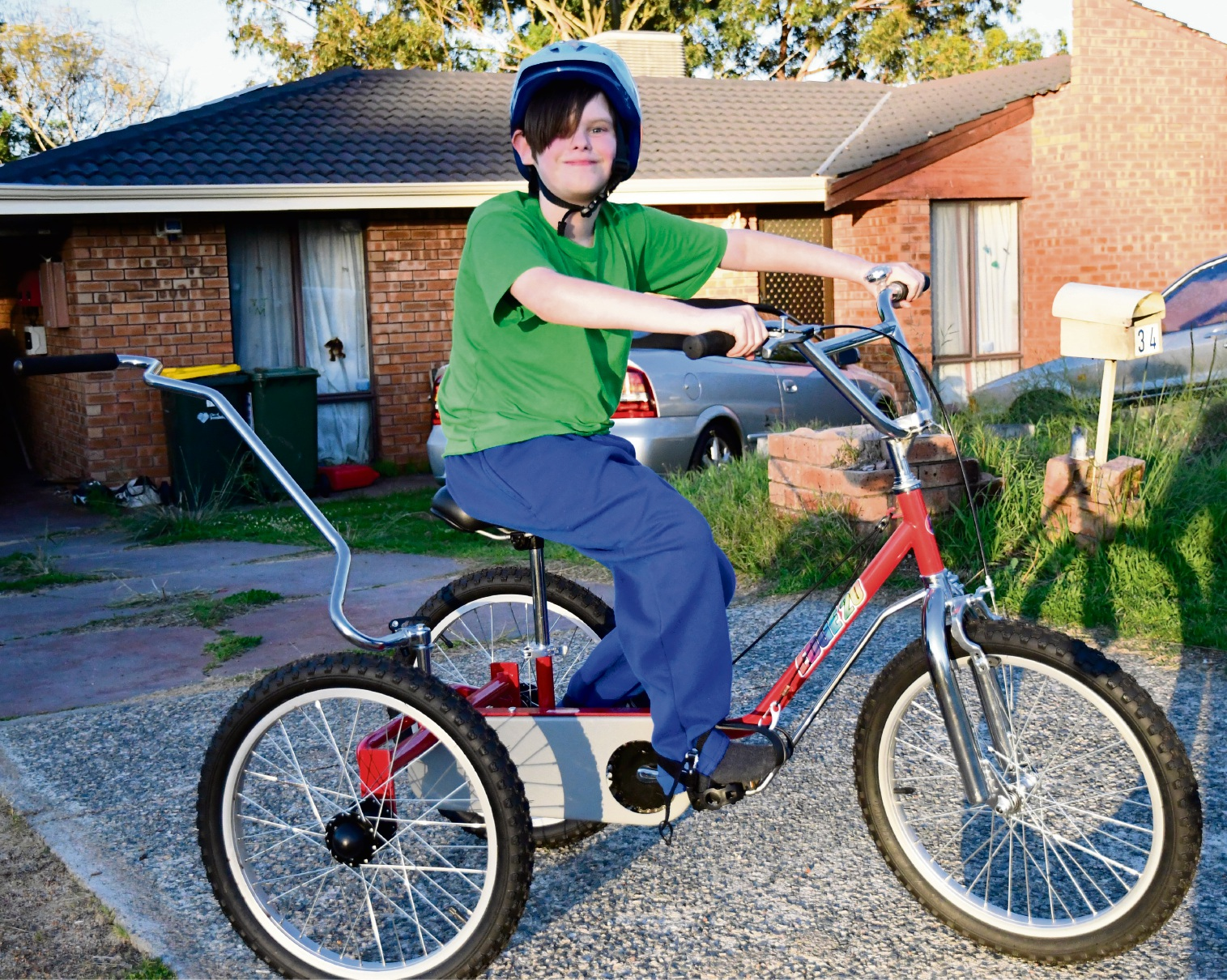 Samson Bartlett (9) with his modified trike.