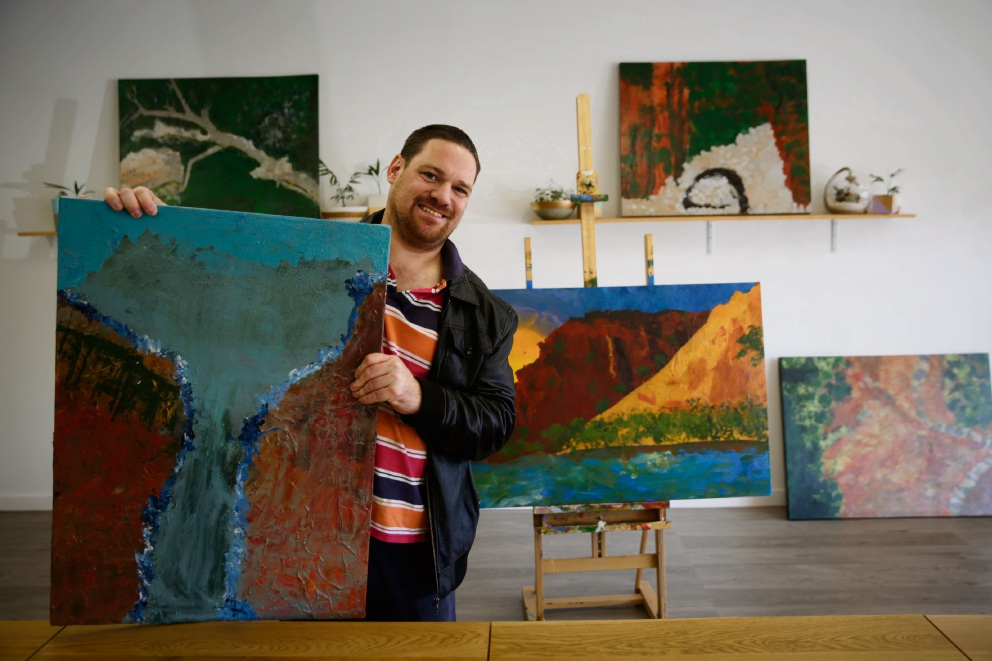 Artist David Tilbrook, who has cerebral palsy, was inspired by the landscape of the Kimberley region in his latest exhibition.