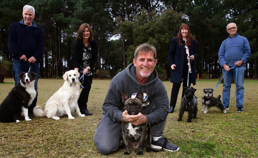 Shaun Johnson with his dog Theo, Ivan and Jo Visic with dogs Harvey and Panda, and Sheila and Marcus Defries with dogs Mabel and Ernie. Picture: Martin Kennealey d472228
