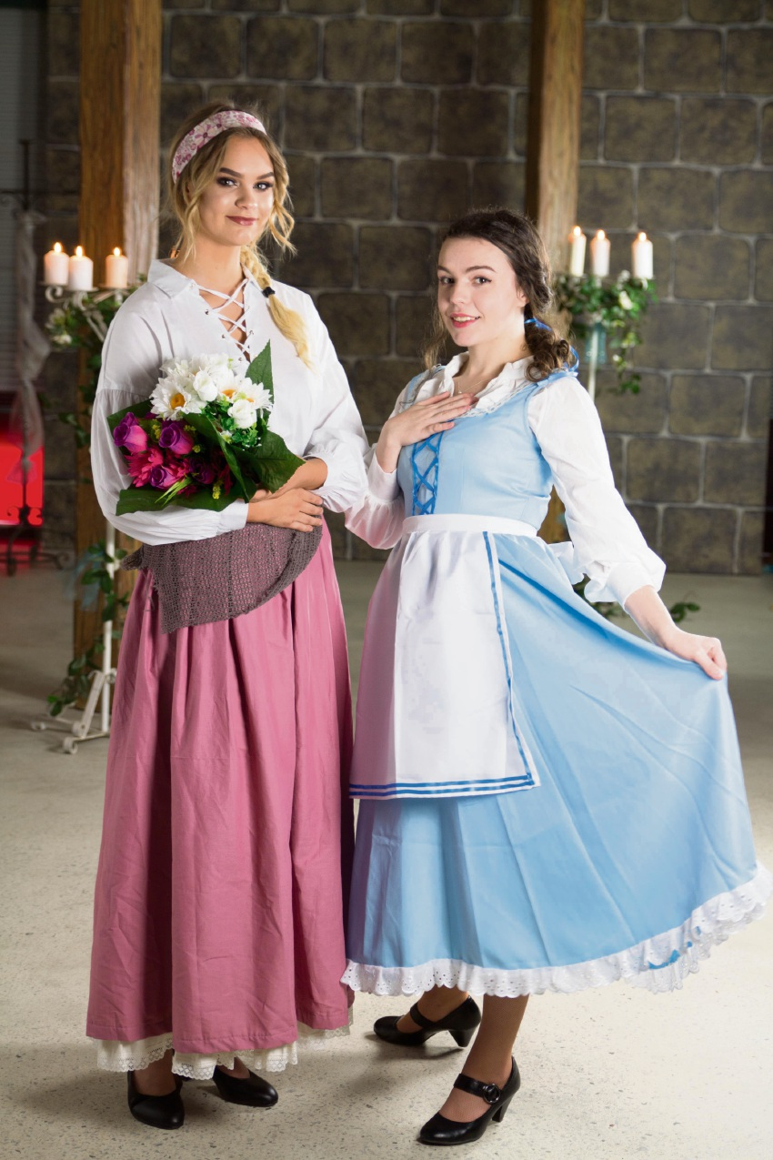 Olivia Morris with Madeleine Shaw who plays Belle, as they rehearse for Disney's Beauty and the Beast.