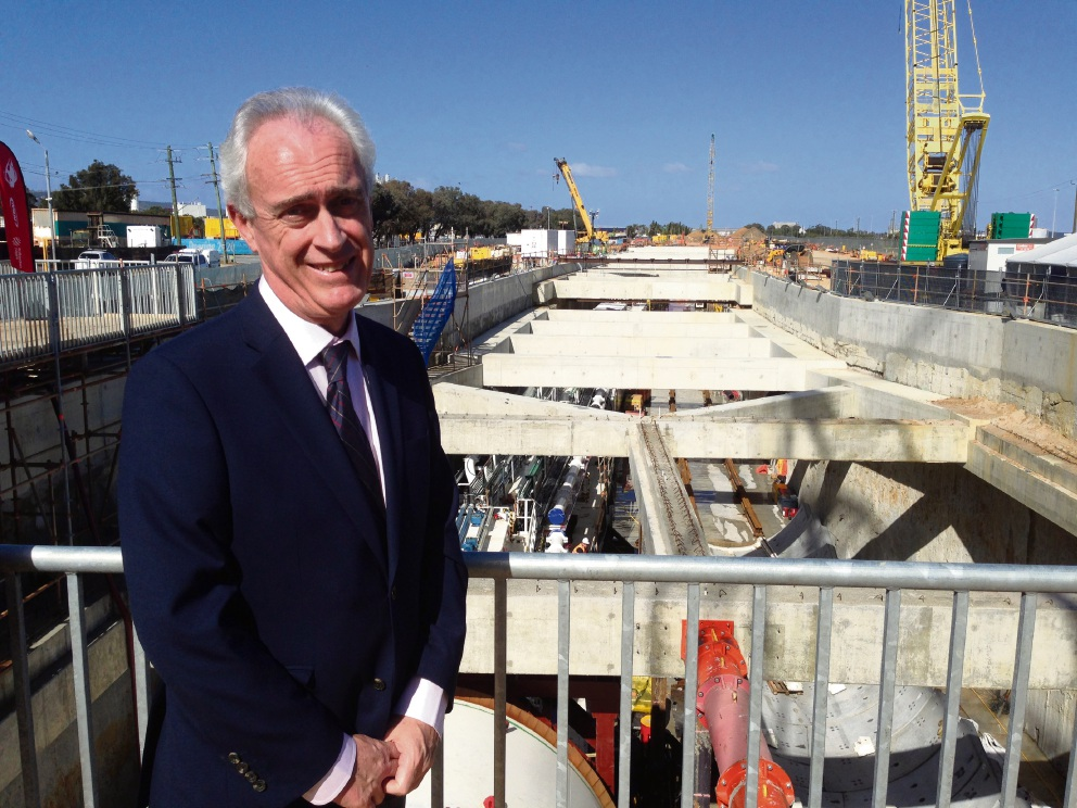 Richard Graham above the entrance to the tunnel at the site of the future Forrestfield train station. Picture: J Bianchini
