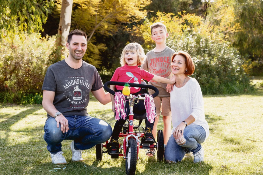 Alice Underwood on her trike with Dad Greg, brother George and mum Charlotte. Picture: Ryan Ammon