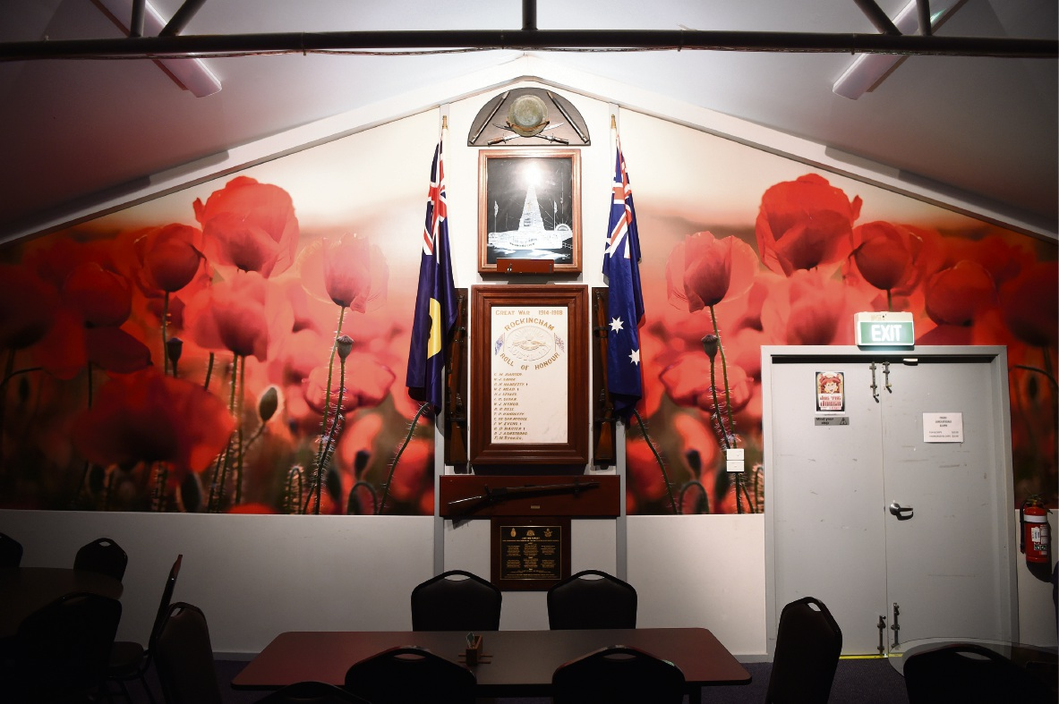 The mural of poppies was hidden until the reading of the Ode, after which it was unveiled to a great response.
