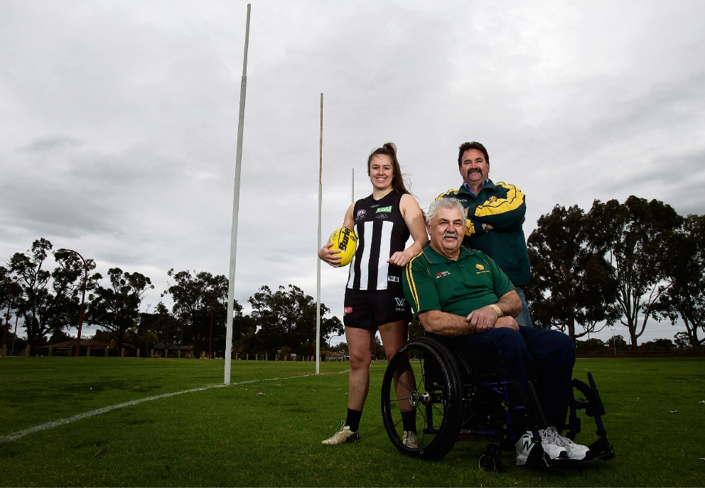 Collingwood's Caitlyn Edwards with Thornlie Football Club's Mick Fraser and Wayne Barrett. Picture: Marie Nirme