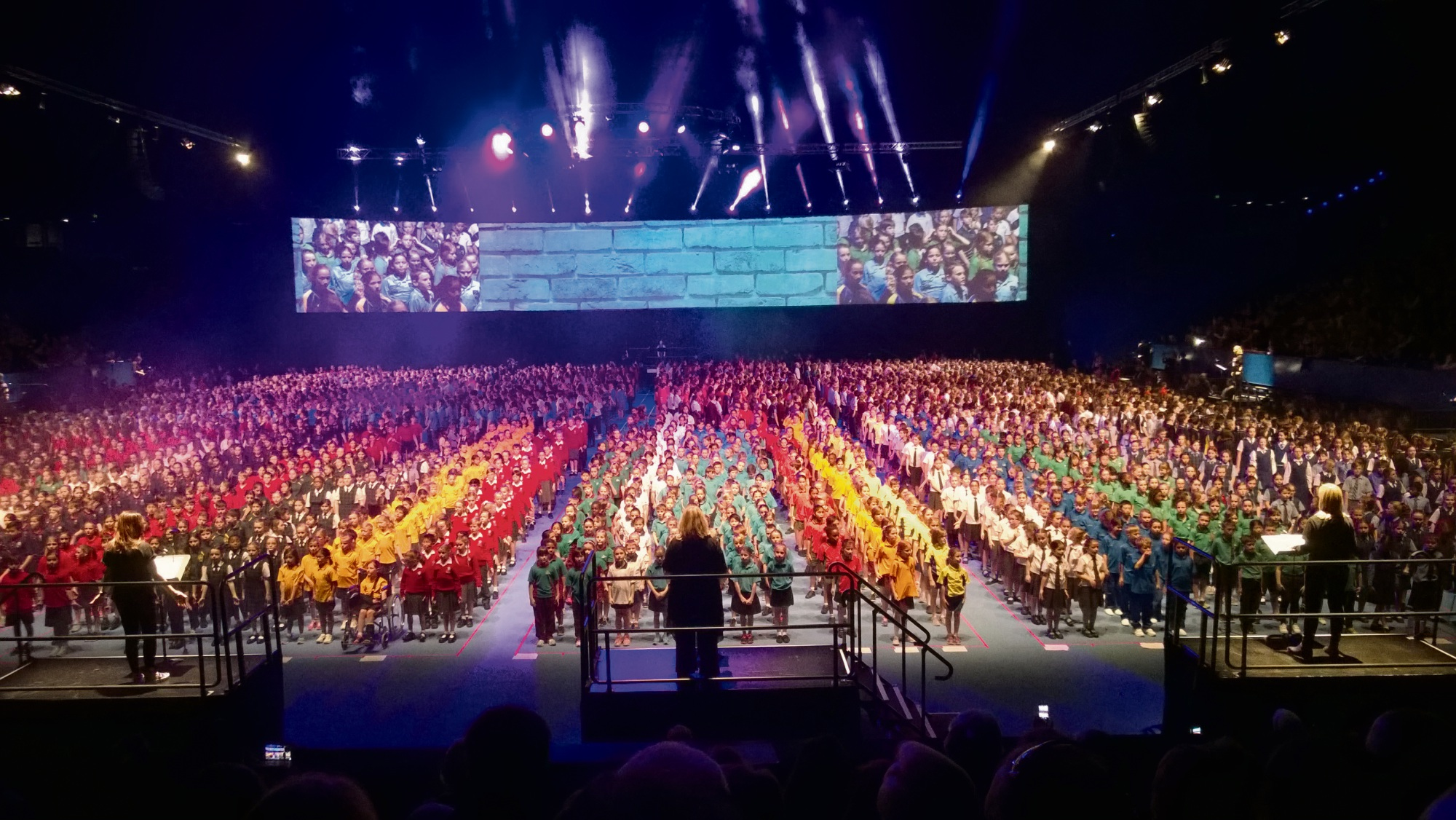 The 4000 strong One Big Voice children's choir perform at Perth Arena.