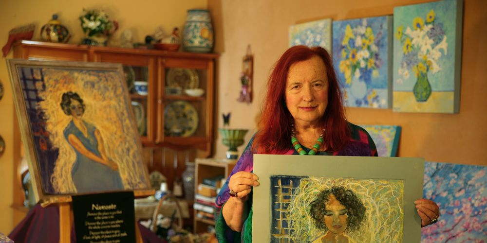 Jacky Hennessy (Bateman) with portraits of her Iranian friend Sarah. Picture: Martin Kennealey d472836