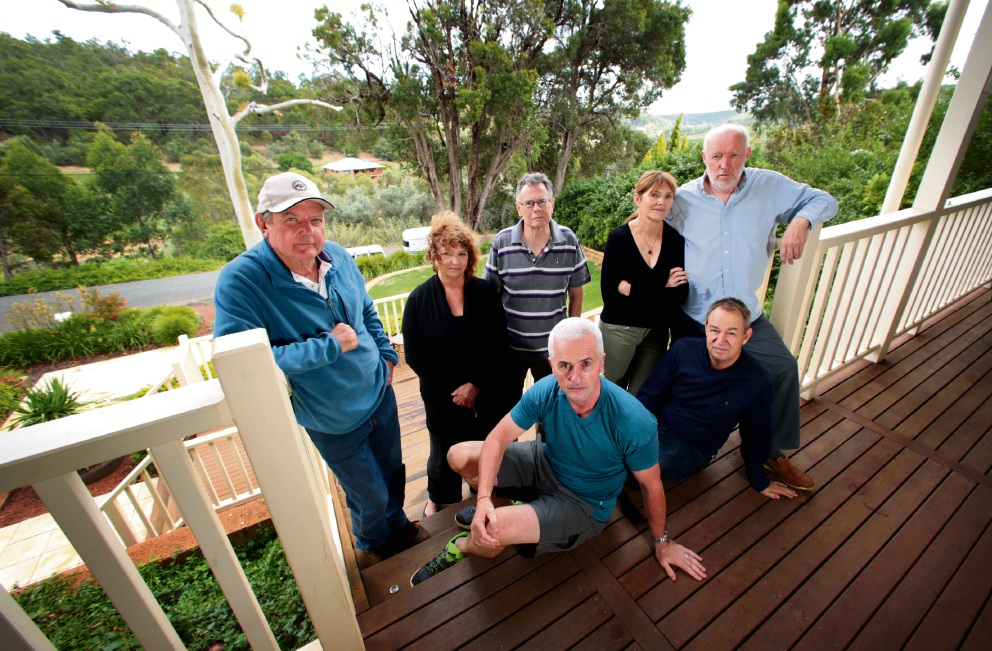 BACK L-R: Ric Sugars, Janis Hughes, Richard Babbage, Jo and Mike O'Donnell.  FRONT L-R: Aidan Cosgrave and Tony Hughes.  Residents along a quiet street in Carmel are opposing plans for a tourism development on Union Road. Picture: David Baylis www.communitypix.com.au   d466575