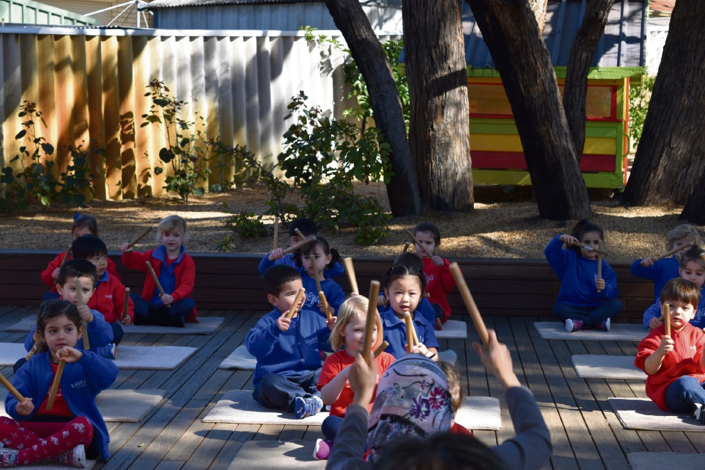 Banksia Montessori School students performing for the guests.