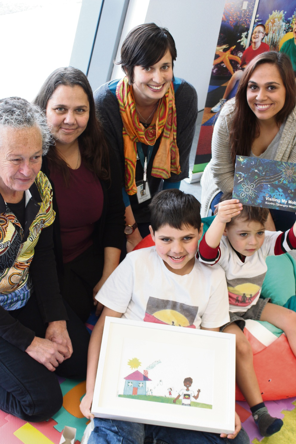 Wendy Wright of the First Peoples Disability Network, Evelyn McKay with sons Daniel (9) and Peter (4) (front), Bethany Cunningham and artist Seantelle Walsh. Picture: Jaime Shurmer