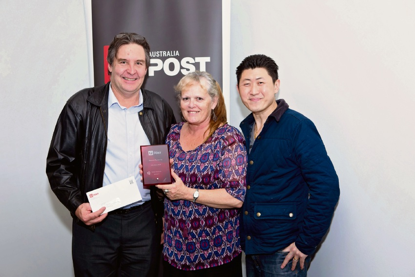 Licensees Keith and Alison Maxwell with Australia Post network manager Alan Tan.