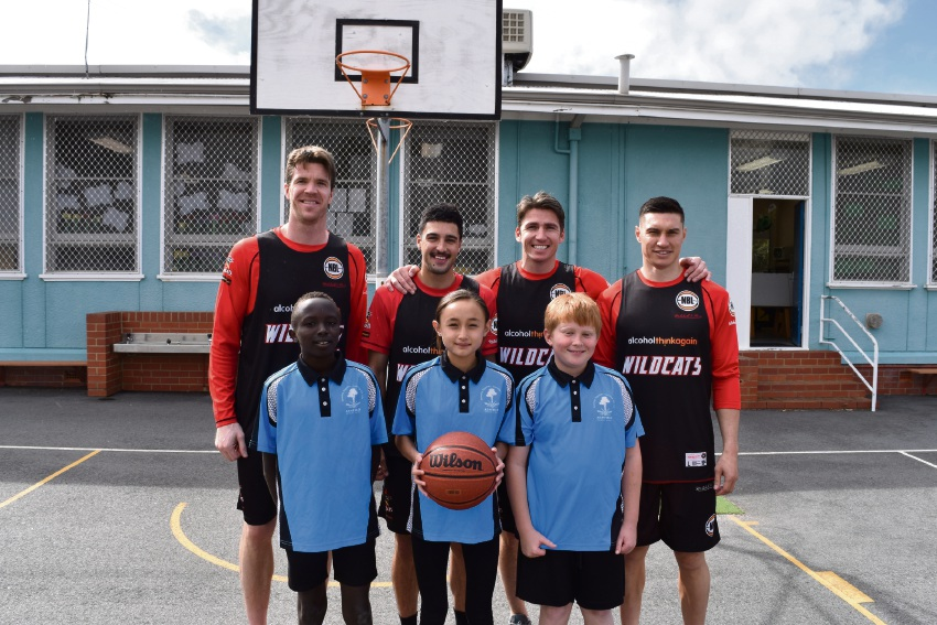 Wildcats players Lucas Walker, Mason Bragg, Damian Martin and Jarrod Kenny with Ashfield students Ben Makhris, Aaliyah Koha and Riley Boyd.