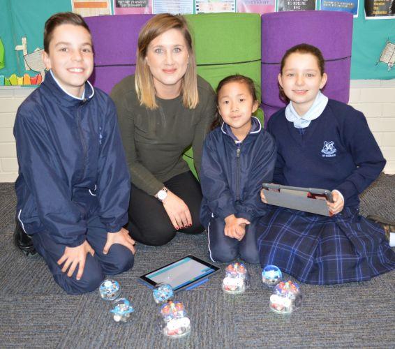 St Kieran students: Braydon Nicolaou (Year 4), Phoebe Behiels (teacher), Isabella Lim (Year 1) and Sabina Catenacci (Year 4).