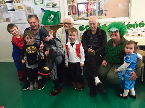 Youngsters with Aegis Aged Care Group residents and centre 2IC Charlene (right).