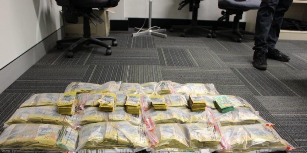 Police uncover $1.6 million cash after stopping hire car in Perth