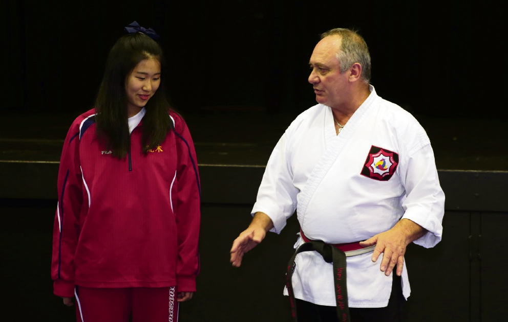 Kokoro Hasegama from Hanazone High School in Osaka with Peter Hunt from Wanneroo Martial Arts. Picture: Martin Kennealey d472287