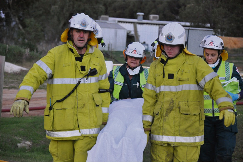 Gingin Volunteer Fire and Rescue Service firefighters Merv Neuendorf and Graeme Maitland-Smith with ambulance officers Irene Neville and Hannah Hart. Pictures: Steven Faulkner, Wanneroo Joondalup SES