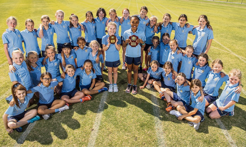 St Hilda's Champion Schools Cross Country team with Alex Fleming (centre left, holding the Champion Schools Cross Country plaque for the Year 4 and Under division) and Busola Oyewopo (holding the 2017 Champion Schools Cross Country plaque).