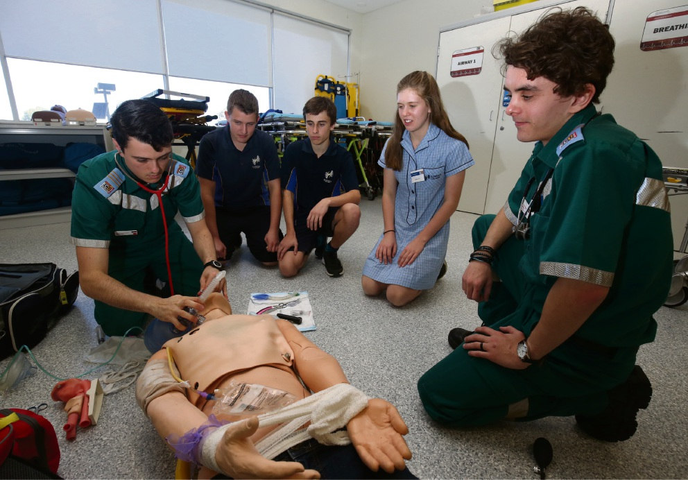 ECU paramedic student Damian Condo with Zac Clement, Devlin MacGilp and Samara Lette from Kinross College and ECU paramedic student Matt Gaston. Picture: Matt Jelonek