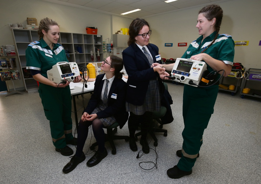 ECU paramedic student Sarah Johnson and Emma Pryce and Sharni Cresswell from Mater Dei College with ECU paramedic student Emily Forrester-Walker. Picture: Matt Jelonek