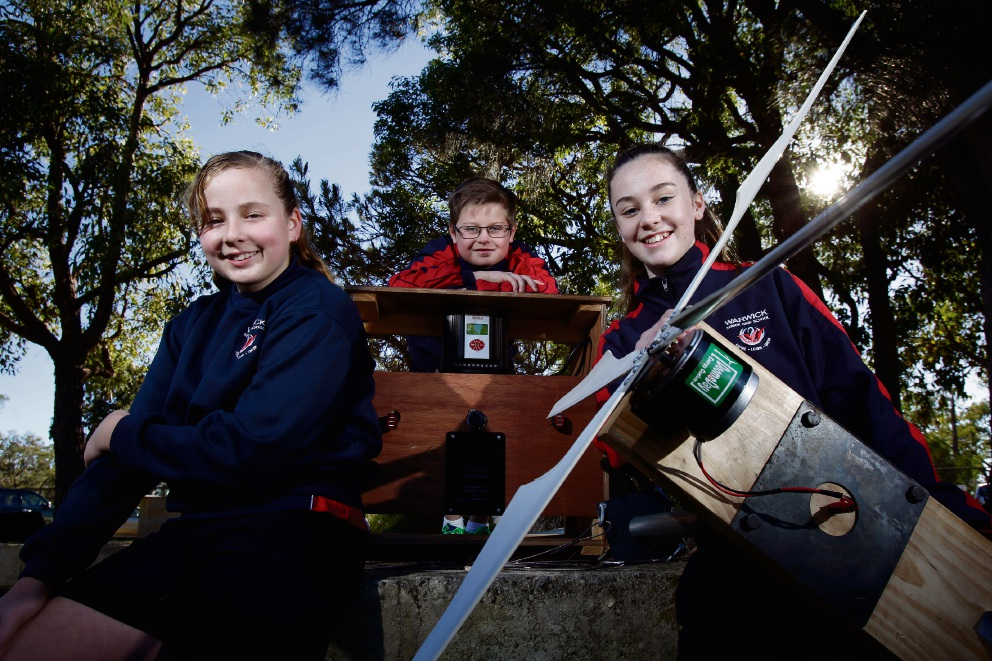 Warwick Senior High School students Charlotte Jolley (12), Blake Bramwell (12) and Brooklyn Lowrie (12) with the wind turbine. Picture: Marie Nirme d470902