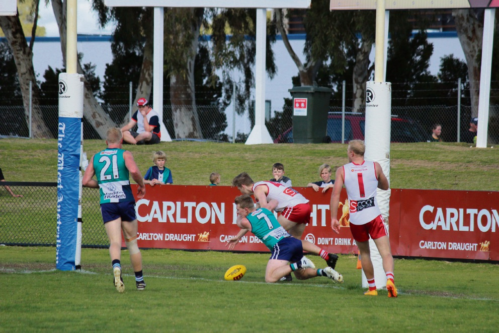 Haydn Matthews reaches for the footy.  Pictures: Gavin Harrison Peel's Calvin Thorn mid-tackle.