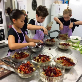 Jarrahdale Primary School's Ellie Arkam, Jared Thompson and Cooper Chamberlain prepare some dishes for parents.
