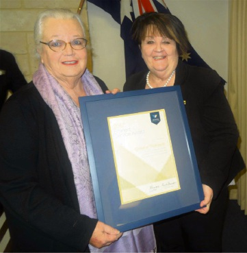 Shire president Maree Reid and Cr Chris Thompson with her award.