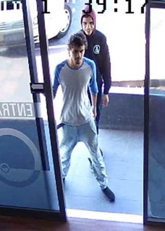 Detectives have released CCTV images of two men they believe can help with an investigation into a Butler Liquor store robbery.