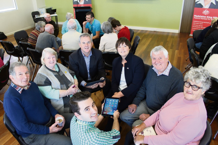 Rockingham seniors Mike Berson, Daphne Hill, Telstra area general manager Boyd Brown, Brand MHR Madeleine King, James Sharkey and Leona Wallace get tips on how to get connected from local Rockingham Telstra team member Hugh McLernon.