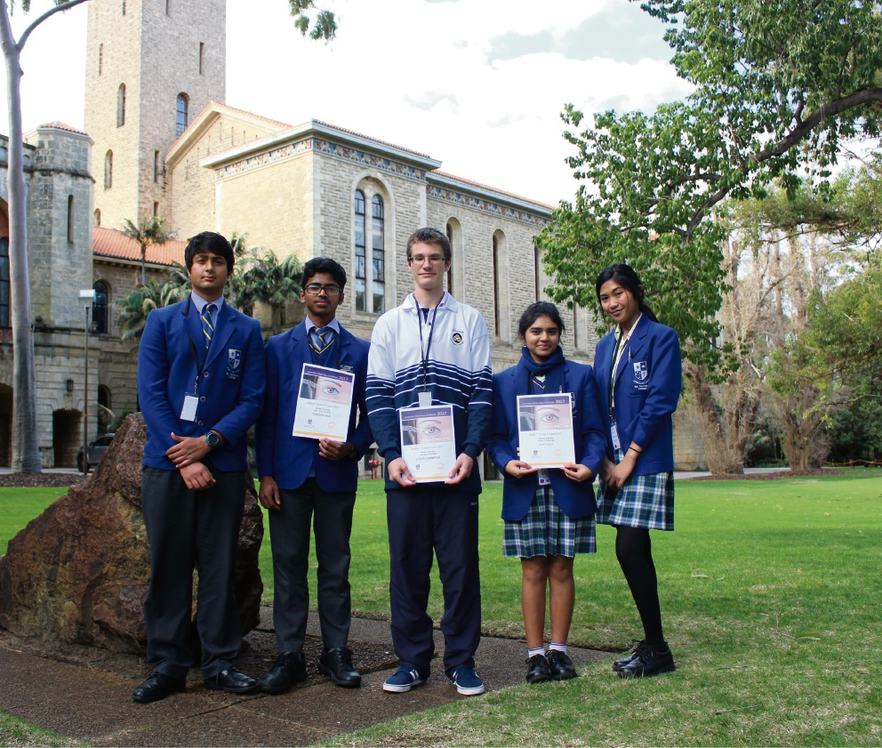 Woodvale Secondary College student Erwin Bauernschmitt (centre) with St Norbert College students.