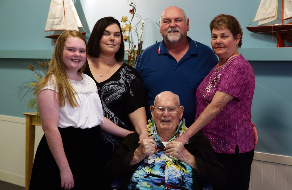 William Gilchrist (seated) with great grand daughter Lilly Gilchrist (10) her mother Zoe, his son Jeff and his wife Wendy celebrating his 100th birthday at Bethanie Beachside. Picture: Martin Kennealey