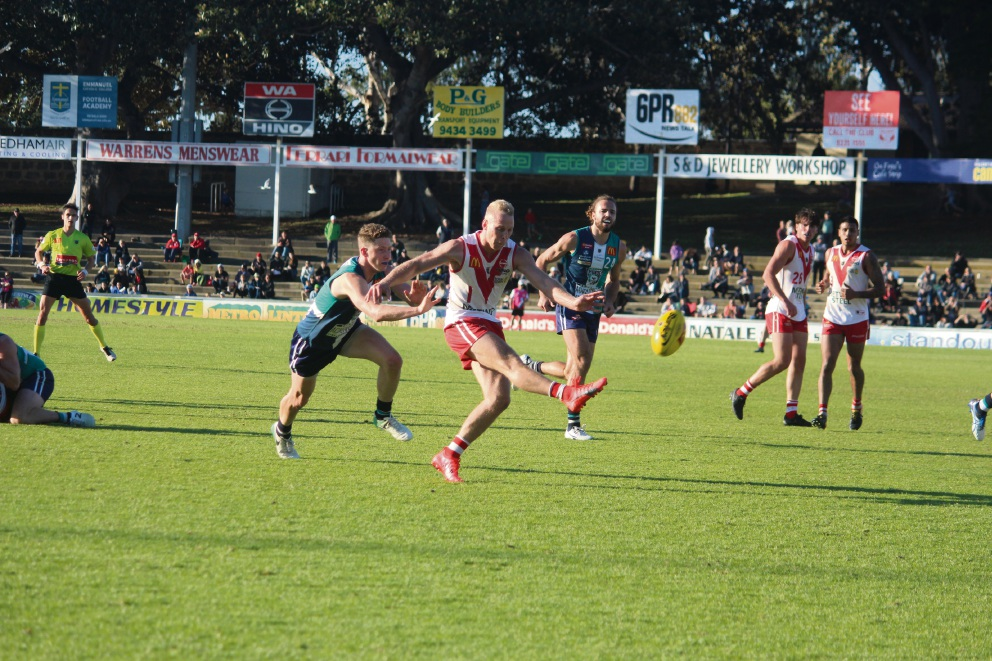 Haiden Schloithe escapes a Zac Dawson tackle to get a kick away. Picture: Lorenzo Lumia