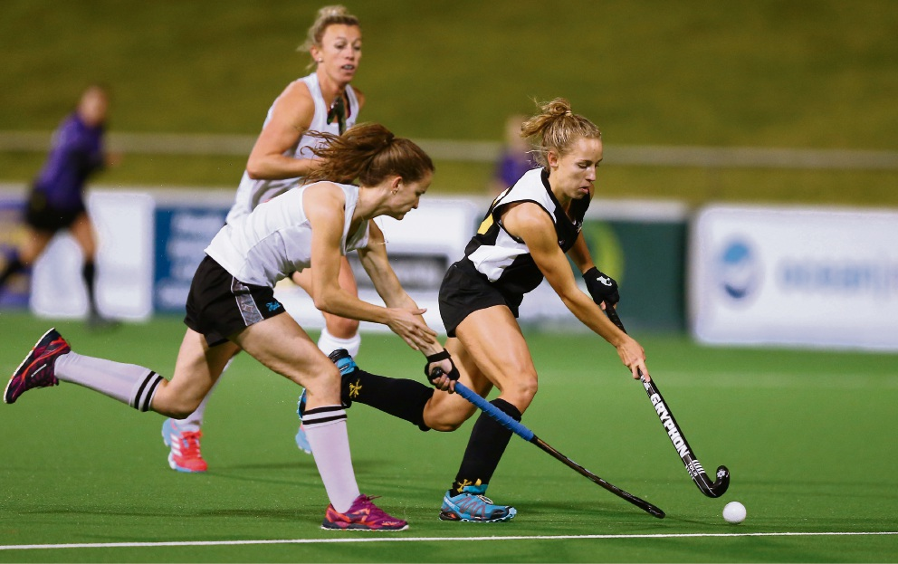 Rivervale's Georgia Wilson (in black) has been named on the WA Diamonds hockey team.