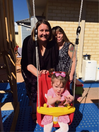 Keeley Temple with daughter Ava and (left) Wanslea Family Day Care's Rebecca Robertson.
