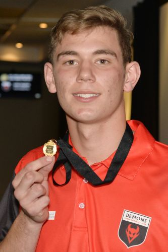 Demons colts player Luke English with the Jack Clarke Medal.