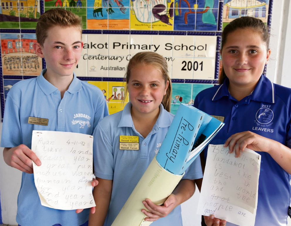 Year 6 students Alex David, Hannah Yarran and Georgia Boak with some of the time capsule material ahead of its official unveiling.  Picture: Martin Kennealey  d473520